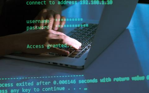 Image of fingers on keyboard with password data.