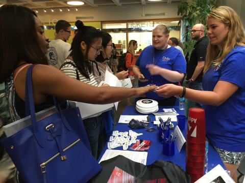 New students visit the OIT table for information at the graduate fair.