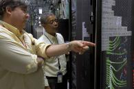 Charley Kneifel and Carl McMillon inspect servers at Duke's Data Center