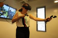 A woman uses a VR headset at the Bolt