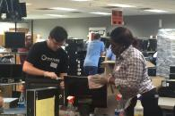 Two NCCU students help refurbish computers for Durham Housing Authority centers