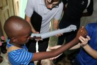 Duke students help fit a Haitian boy with 3D printed arm