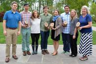 Eight Duke 2015 sustainability awards winners pose with wooden awards.